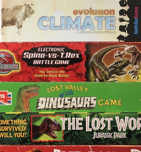 image of dinosaur themed board game boxes